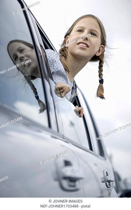 Girl looking through car window
