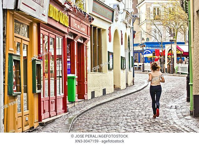 Woman running, Rue Norvins, Montmartre, 18th arrondissement, Paris, France, Europe