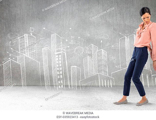 Businesswoman pushing against wall with city drawings