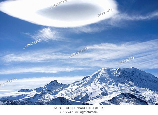 Mount Rainier National Park, Washington: A lenticular cloud forms over the summit of Mount Rainier as an autumn weather system moves in