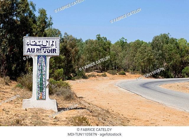 Tunisia - Cap Bon - Road sign Au Revoir when leaving a village on the Korbous road