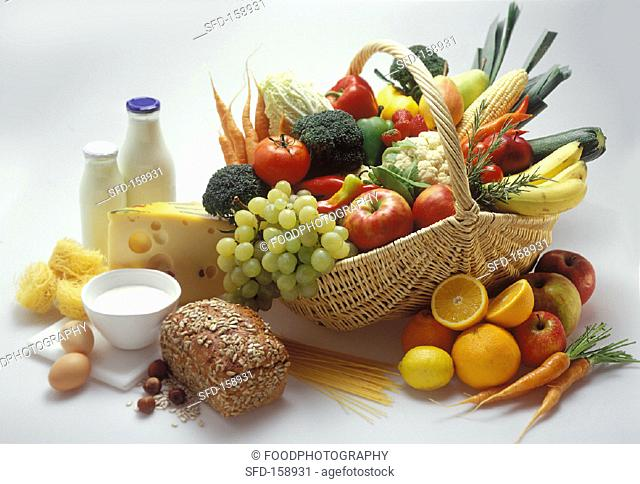 Various foodstuffs in and beside a basket (2)