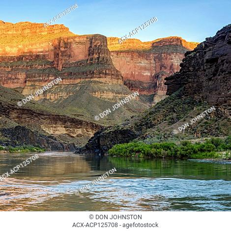 Evening light reflecting off Grand Canyon walls into the Colorado River at Blacktail Canyon camp, Grand Canyon National Park, Arizona, USA
