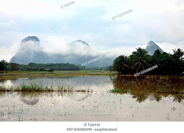 Mountain name Khao Oktalu or The Hole Mountain at Phatthalung Province Thailand