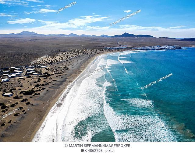 Beach Playa Famara and Caleta de Famara, drone shot, Lanzarote, Canary Islands, Spain