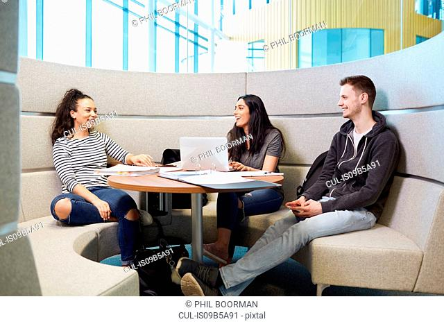 University students relaxing in modern seating area