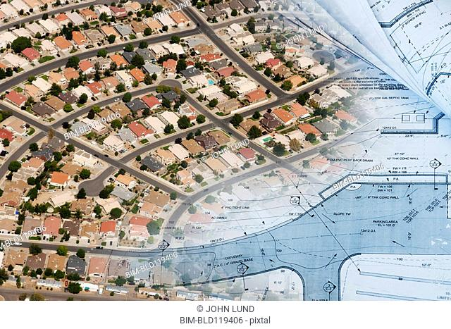 Aerial montage of suburbs with blueprints