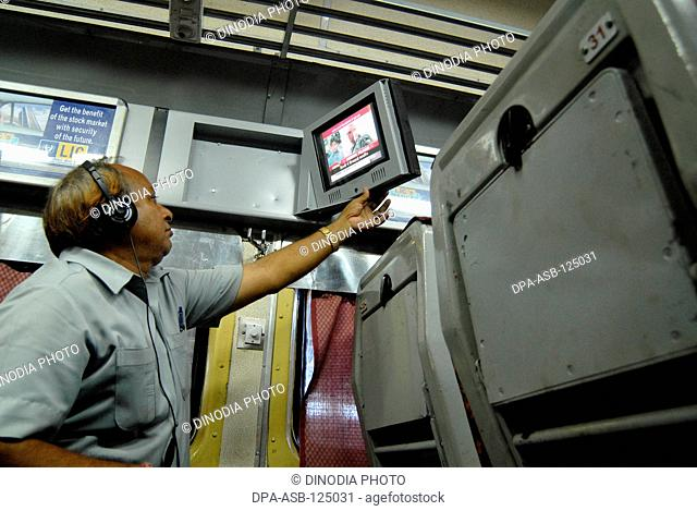 Passenger watching television introduce by Indian Railways on experimental basis in one of air conditioned bogie at Mumbai Central railway station in Bombay...