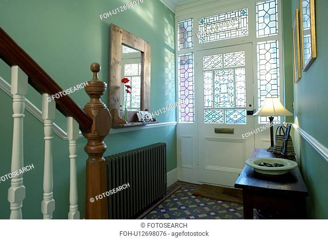 Stained glass windows and half-glazed door in traditional green hall