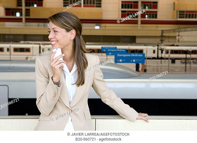 Businesswoman. AVE, Tren Alta Velocidad. Delicias station, Zaragoza, Aragón. Spain