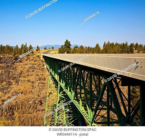 Truss Bridge and Rocky Cliff Face