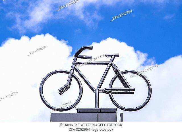 Steel bicycle against a blue sky with clouds in Eindhoven, The Netherlands, Europe