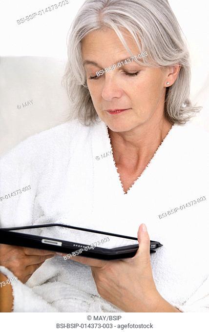 senior woman using tablet computer