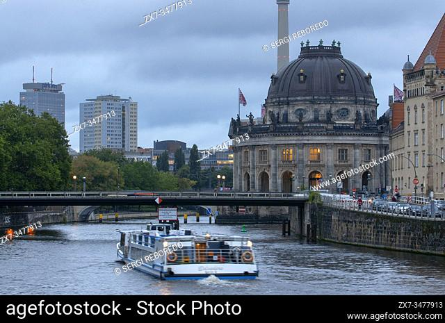Beautiful view of historic Bode Museum Berlin Museumsinsel and Spree river in twilight during blue hour at dusk, Berlin Germany