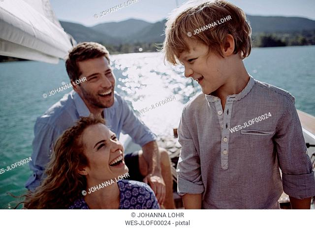 Happy family on a sailing boat