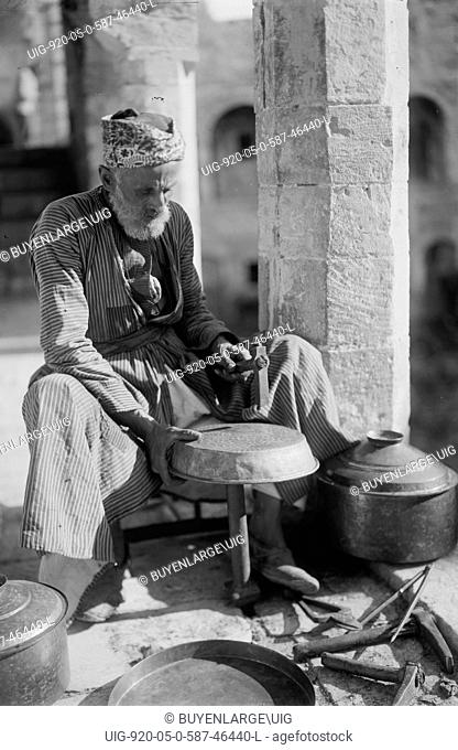 Coppersmith Hammers a Pot into shape 1930