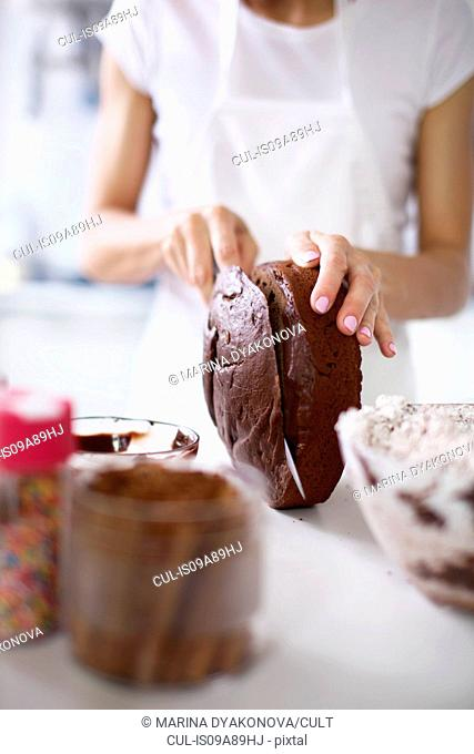 Woman slicing top off cake