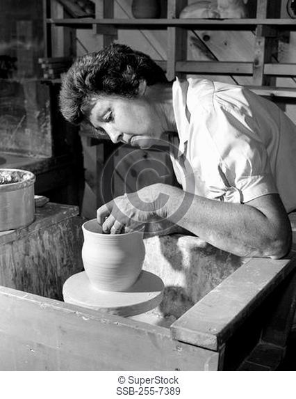 Potter making pottery on a pottery wheel
