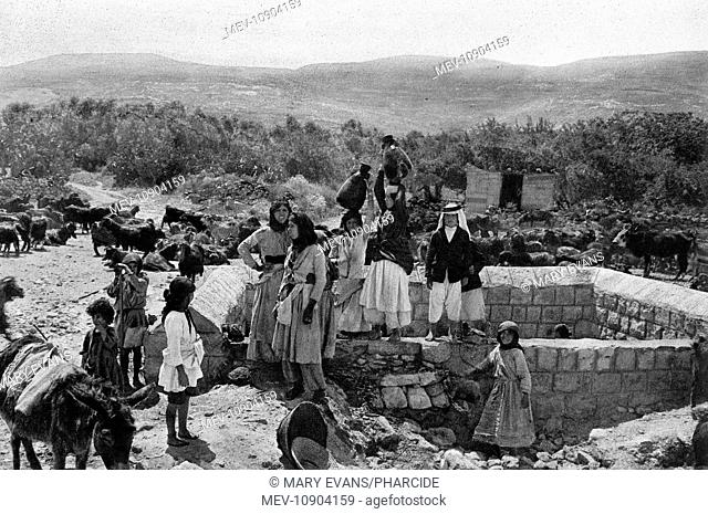 People collecting water at the well in Cana, Galilee, Northern Israel. According to biblical legend, it was in Cana that Jesus turned water into wine at a...