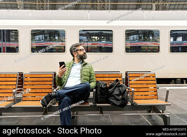 Man sitting on a bench at the train station
