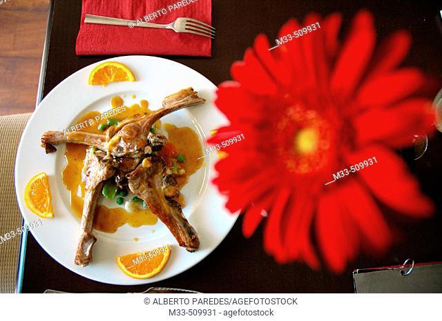 Lamb chops with orange. El Pecado Restaurant. Jaén. Andalusia, Spain