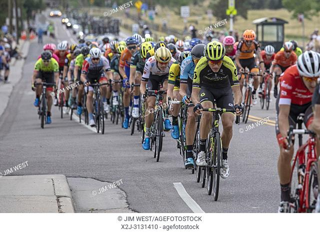 Denver, Colorado USA - 18 August 2018 - Riders in Stage 3 of the men's Colorado Classic bicycle race ride through suburban Wheat Ridge on their way to the...