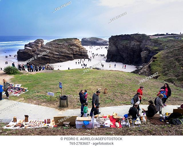 One of the most visited beaches of Galicia. In the Mariña Lucense, sand overview, subvenir and sellers in the foreground