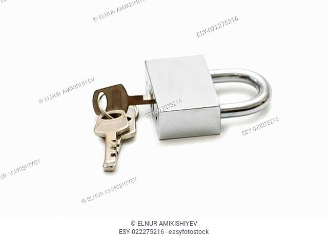 Silver padlock and keys isolated on the white
