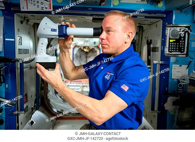 Expedition 47 Commander Tim Kopra of NASA participates in the Ocular Health investigation aboard the International Space Station
