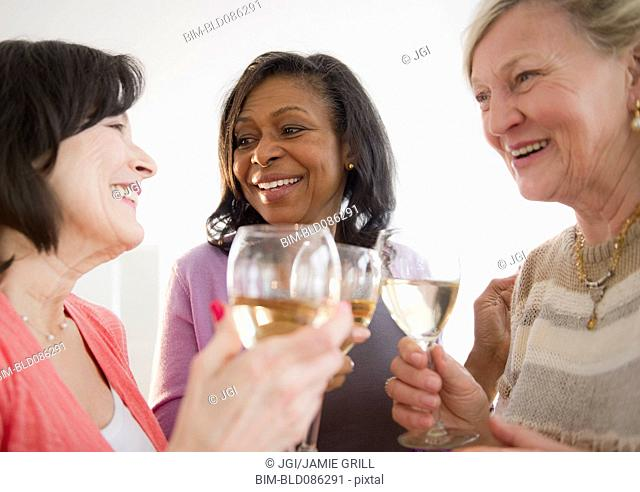 Friends drinking white wine together