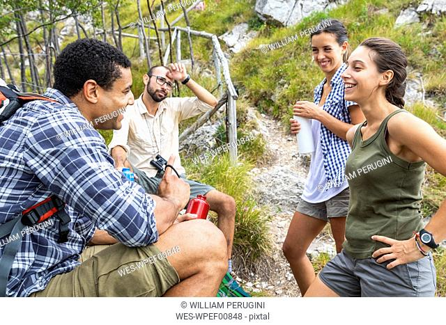 Italy, Massa, hikers taking a rest during a day in the Alpi Apuane mountains