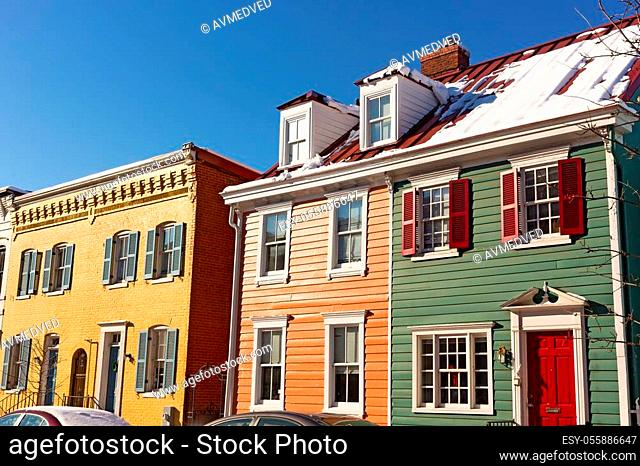 Colorful townhouses in a bright winter morning after snowstorm