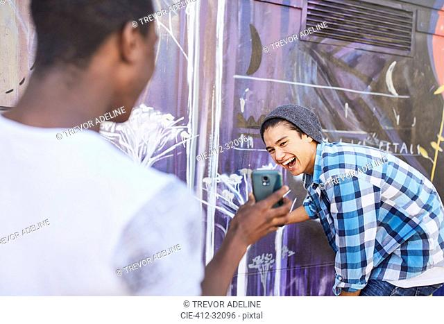 Teenage boys with cell phone laughing
