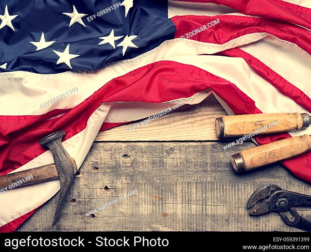 Flag of the United States on a wooden workbench with space for text