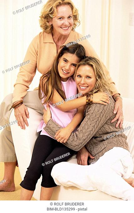 Three generations of women hugging