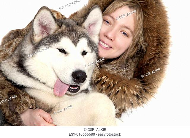 Malamute puppy with a girl