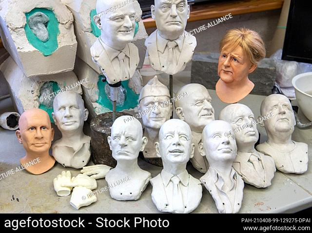 08 April 2021, Saxony, Lichtenstein: A selection of half-finished portrait busts of prominent faces stand in Brigitte Schneider's workshop