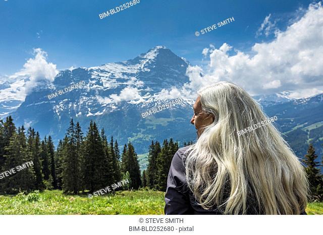 Caucasian woman admiring scenic view of mountain