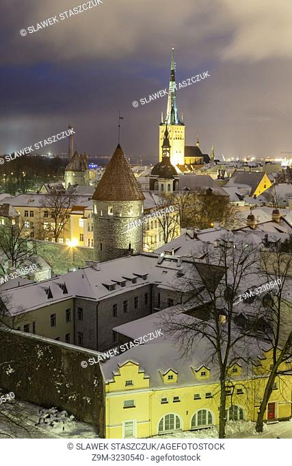 Winter evening in Tallinn old town, Estonia. St Olaf's church dominates the skyline