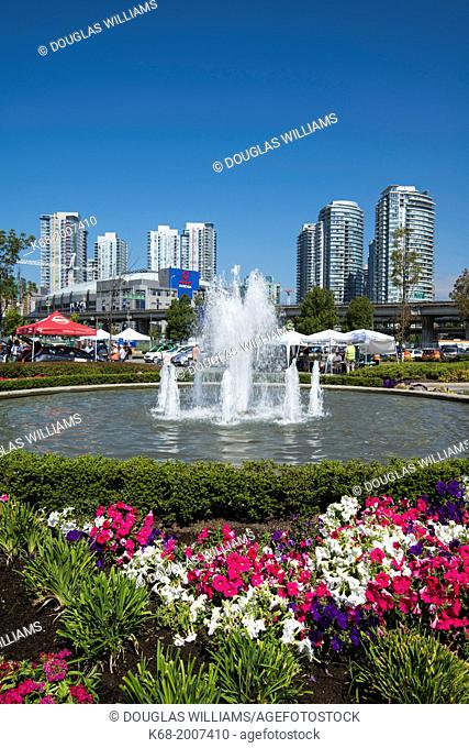 flowers and fountain at north west False Creek, Vancouver, BC, Canada