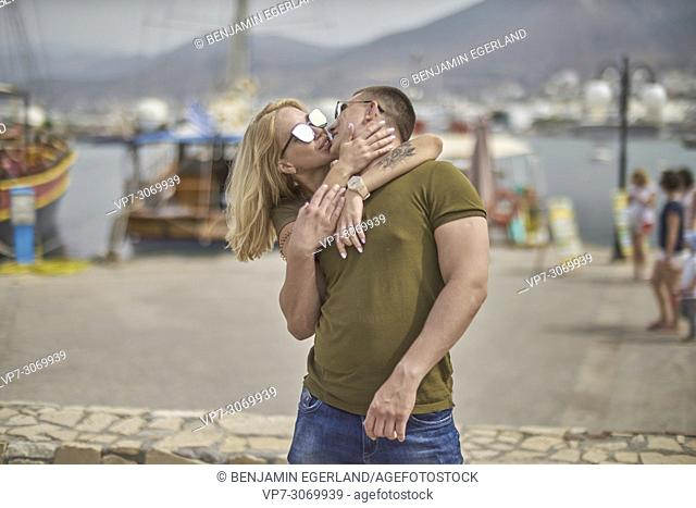 Happy young couple kissing, Russian ethnicity, Hersonissos, Crete, Greece