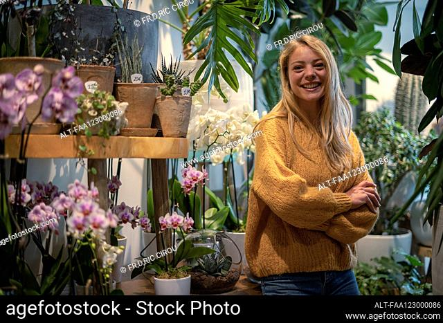 Young woman standing in flower shop