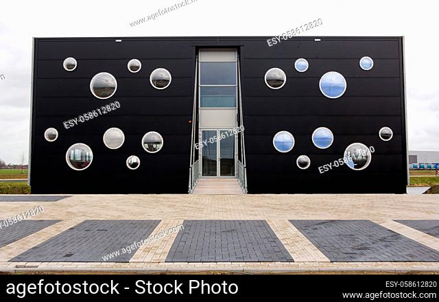 Modern black office building with all kinds of round windows