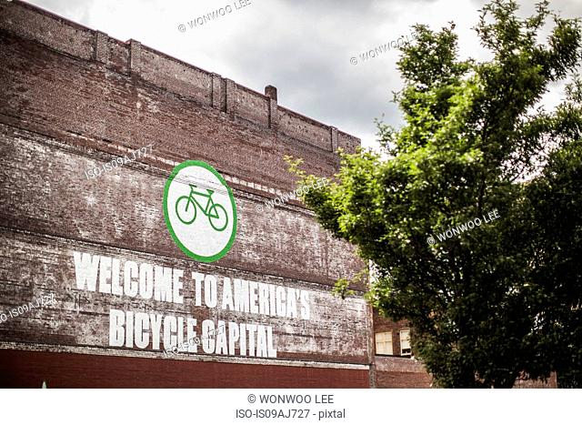 Wooden sign Welcome to America's Bicycle Capital, Portland, Oregon, US