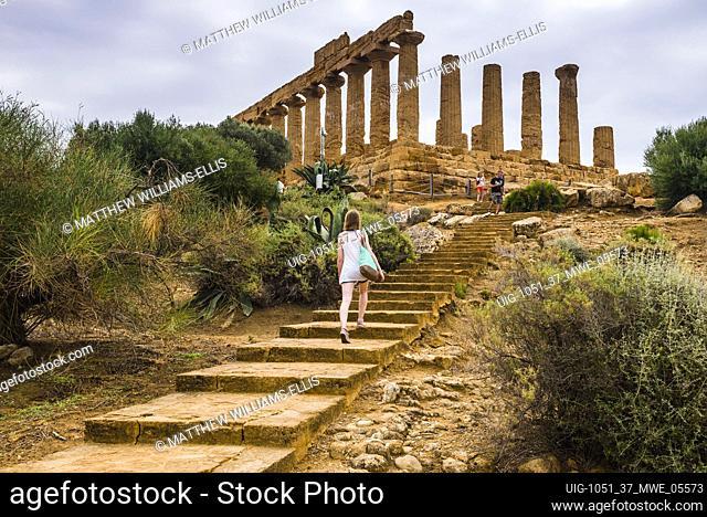 Tourist sightseeing at Valley of the Temples (Valle dei Templi), Temple of Juno (Tempio di Giunone), Agrigento, Sicily, Italy, Europe