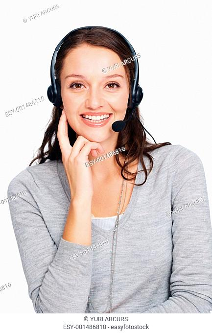 Portrait of beautiful female call center employee smiling with headset