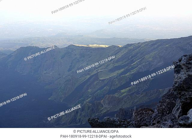 07 September 2018, Italy, Etna: Scree fields of lava rock, which are again overgrown with green on Etna. Etna (Italian Etna or Mongibello) is an active and with...