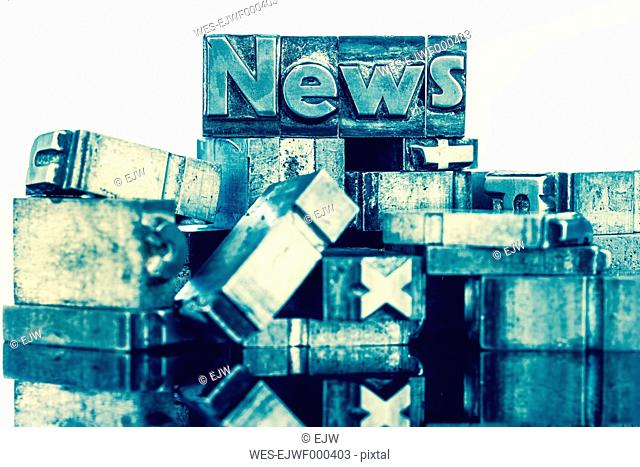 Old metal types forming the word news