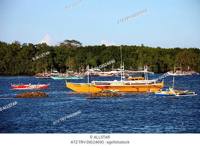 COLOURFUL JUKUNG FISHING BOATS; PUERTO PRINCESA, PHILIPPINES, ASIA; 23/04/2015
