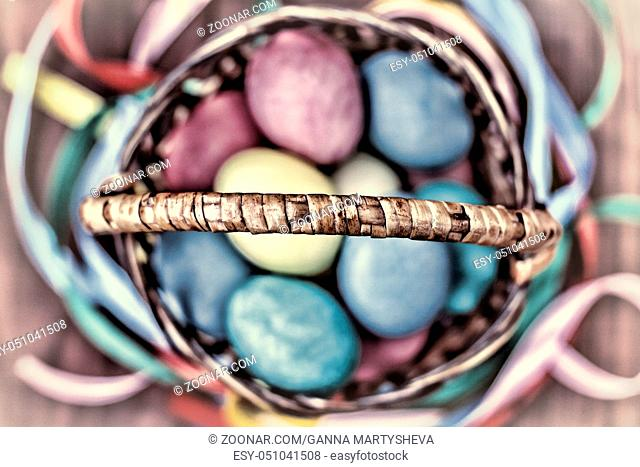 Easter eggs. Easter multicolored ribbons on a wooden table, top view. selective focus
